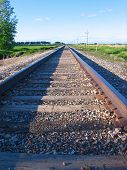 stock photo of transcontinental  - Railroad tracks extending into the distance - JPG
