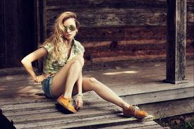 image of short legs  - Trendy Hipster Girl Sitting on the Wooden Porch - JPG