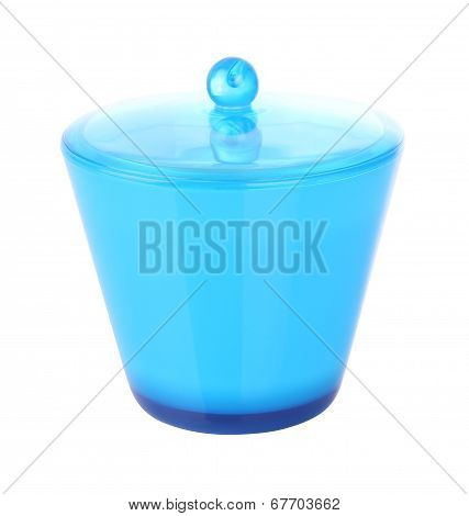 Side of blue plastic jar with cover on white background.