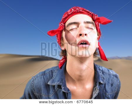 Young Man With Eyes Closed Wearing Bandana