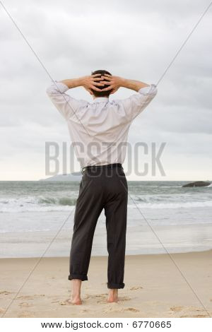 Businessman Relaxing On Beach