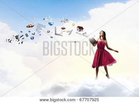 Young woman in rd dress reading book