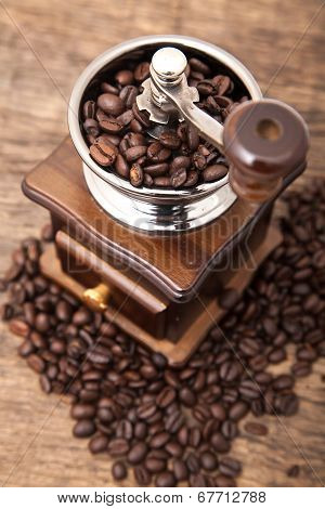Close Up Fresh Coffee Bean In Coffee Bean Grinder