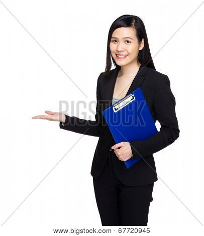 Businesswoman with clipboard and hand present something