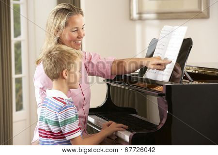Young boy in lesson with piano teacher