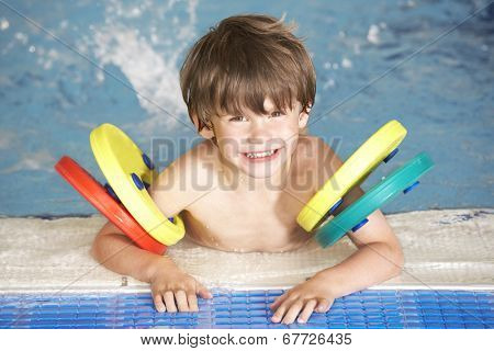 Young boy in swimming pool