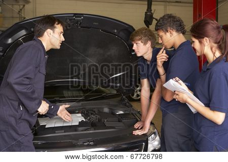 Trainee mechanics at work