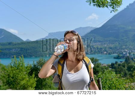 Pretty Young Woman Is Resting During A Hike In The Mountains