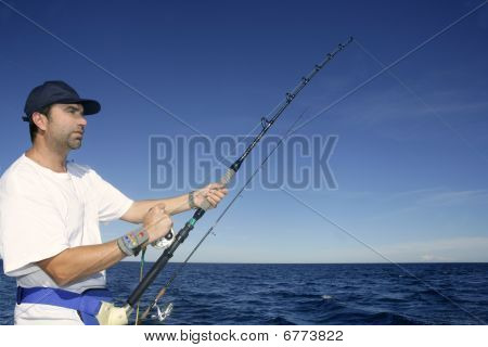 Angler Fisherman Trolling Rod And Reel Fishing