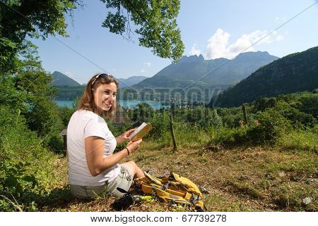 Pretty Young Woman Is Hiking In Mountains