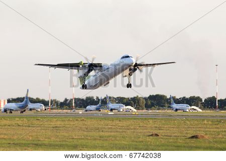 Departing airBaltic De Havilland Canada DHC-8-402Q Dash 8 aircraft