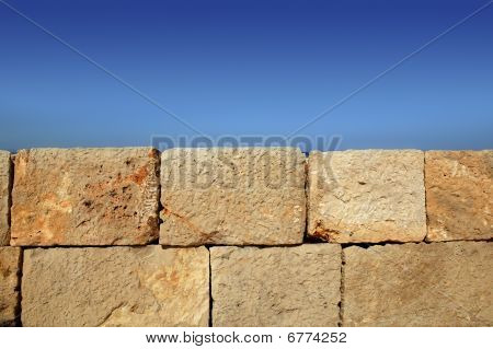 Big Stone Bricks Masonry Wall On Port Blue Sky