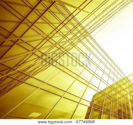 Panoramic and perspective wide angle view to steel light yellow background of glass high rise building skyscraper commercial modern city of future. Business concept of successful industry architecture