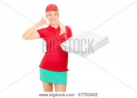 Delivery girl making a call sign and holding pizza boxes isolated on white background