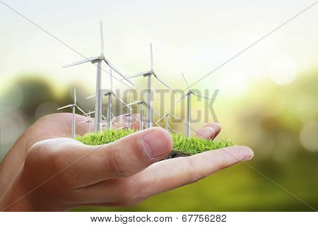 Wind turbine in a man hand