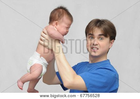 Confused Dad Holds His Crying Child
