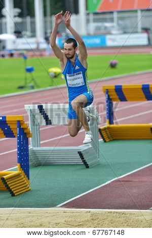 ZHUKOVSKY, MOSCOW REGION, RUSSIA - JUNE 27, 2014: Maksim Nesterenka of Belarus performs triple jump during Znamensky Memorial. The competitions is one of European Athletics Outdoor Classic Meetings