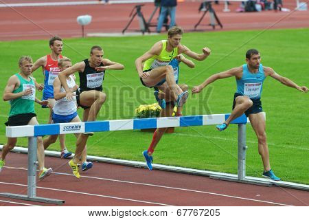 ZHUKOVSKY, MOSCOW REGION, RUSSIA - JUNE 27, 2014: Start of men 2000 meters during Znamensky Memorial. The competitions is one of the European Athletics Outdoor Classic Meetings