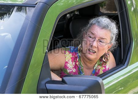 Angry Senior Woman Driver With Road Rage