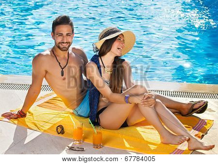 Happy Carefree Couple Relaxing Poolside