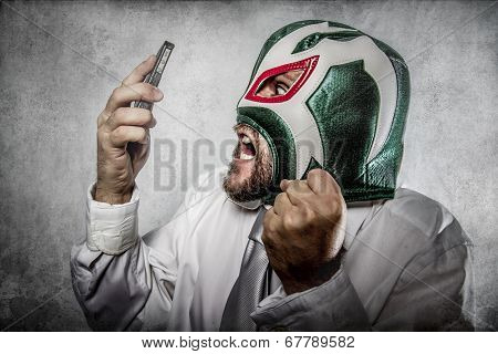 Office man arguing by phone, aggressive executive suit and tie, Mexican wrestler mask