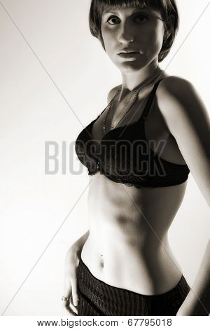 navel piercing beautiful woman. indoor shot