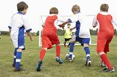 stock photo of little-league  - Junior 5 a side teams playing football - JPG