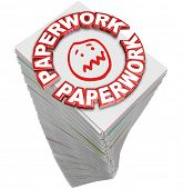 stock photo of frazzled  - Paperwork word in 3d red letters on a stack of papers you must fill out in busy work - JPG