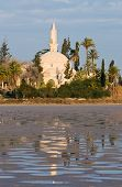stock photo of larnaca  - Hala Sultan Tekke or Mosque of Umm Haram is a Muslim shrine on the west bank of Larnaca Salt Lake in Cyprus - JPG