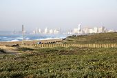 picture of beachfront  - Landscape of dune rehabiliation taking place on beachfront with Durban City Skyline in background - JPG