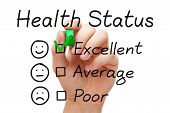 stock photo of status  - Hand putting check mark with green marker on excellent in Health Status evaluation form - JPG