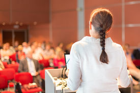 pic of professor  - Female academic professor lecturing at Conference - JPG