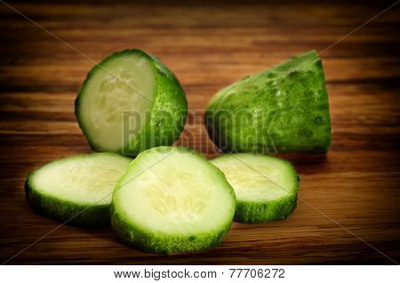 Close-up image of a cucumber slices on wooden background