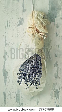Bunch of dried lavender hanging on a coat rack