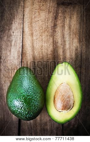 ..avocado Fruit Over Wooden Background. Fresh Green Avocado Fruit Macro.