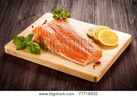 Fresh raw salmon fillet on cutting board