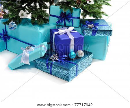 blue gift boxes under Christmas tree.isolated on white