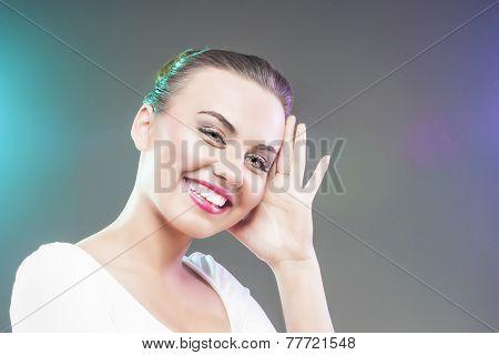 Portrait Of Happy Smiling Caucasian Brunette Woman Touching Head
