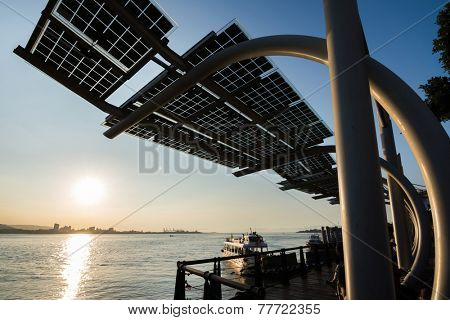TAIPEI, TAIWAN - November 21th : The Sunset in the pier of Tamsui, Taiwan on November 21th, 2014.