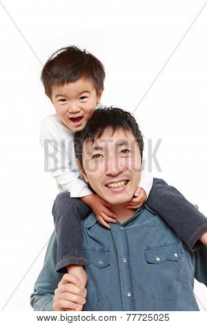 father giving his son piggy back