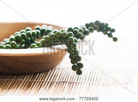 A fresh  green pepper bunch in an earthen bowl.
