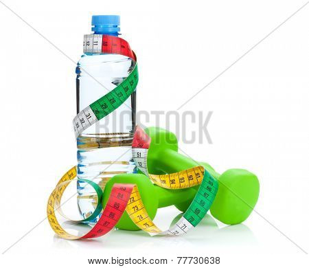 Two green dumbells, tape measure and water bottle. Fitness and health. Isolated on white background