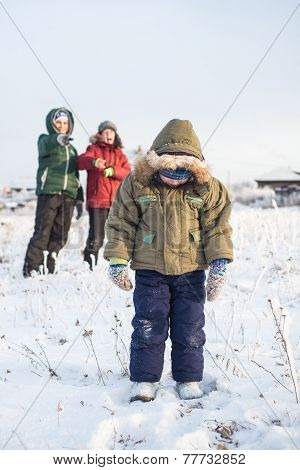 children mock child outdoors in winter on the street