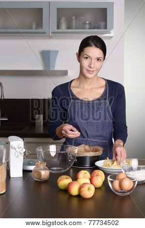 Smiling Young Woman Baking An Apple Tart