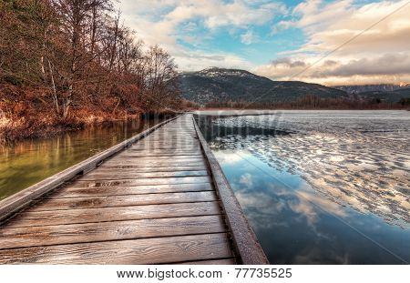 Boardwalk On Lake With Melting Ice