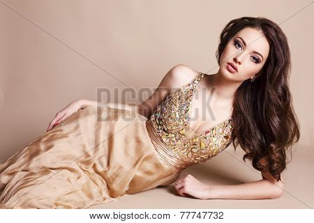 Beautiful Woman With Dark Hair In Luxurious Silk Dress