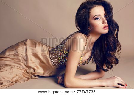 Beautiful Brunette Wearing Luxurious Sequin Silk Dress