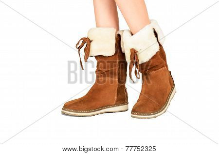 Girls Legs In Boots Side View Isolated On The White Background