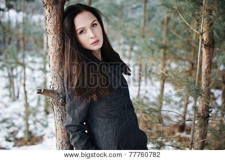 beautiful girl alone in winter forest