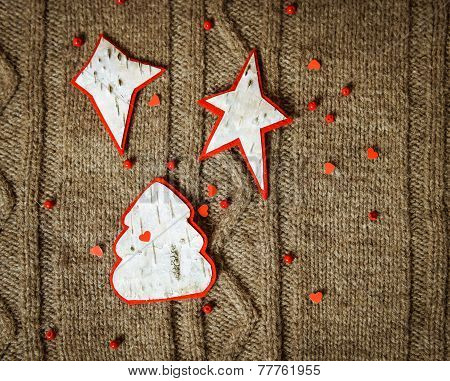 Handmade Christmas decoration on warm knitted background. New year concept. Vintage christmas card w